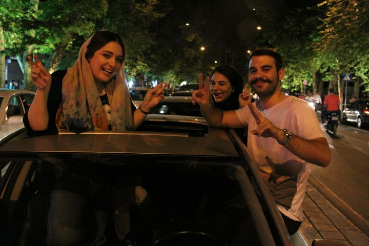 Iranian people celebrate the nuclear agreement between Iran and the P5+1 world powers on July 14, 2015 in Tehran, Iran.