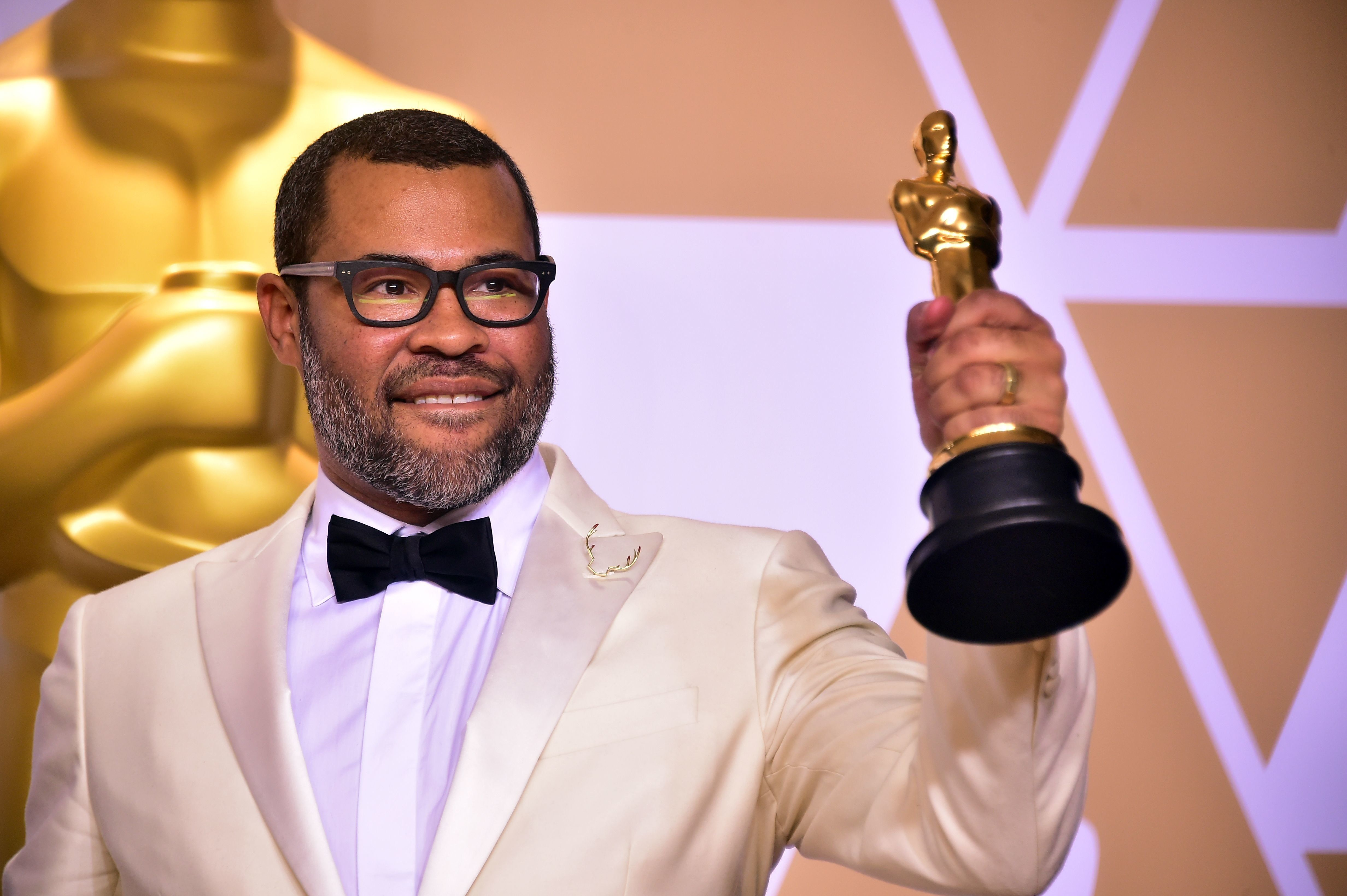 Director Jordan Peele poses in the press room with the Oscar for best original screenplay during the 90th Annual Academy Awards on March 4, 2018, in Hollywood, California.  / AFP PHOTO / FREDERIC J. BROWN        (Photo credit should read FREDERIC J. BROWN/AFP/Getty Images)