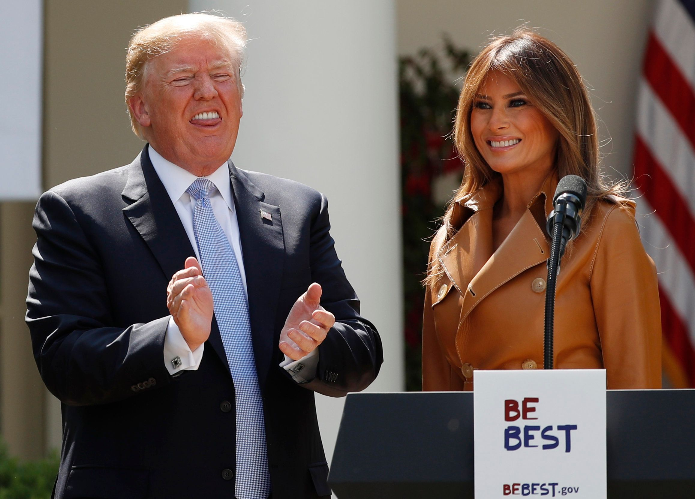 U.S. first lady Melania Trump stands with President Donald Trump, who applauds during the launch of the first lady's Be Best initiatives in the Rose Garden of the White House in Washington, U.S., May 7, 2018. REUTERS/Kevin Lamarque