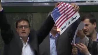 Iranian lawmakers burned a paper American flag after the US pulled out of the nuclear treaty