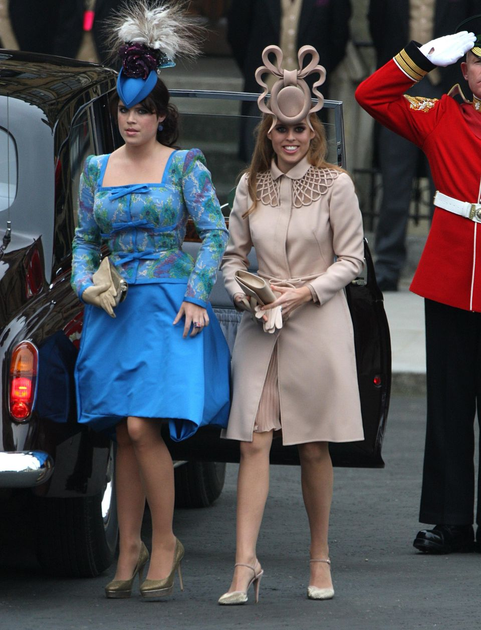 Princesses Beatrice (right) and Eugenie stole the show and William and Kate's 2011 wedding with their...
