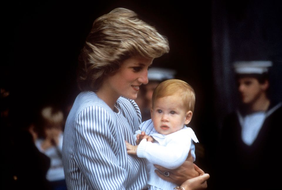 Princess Diana holding Prince Harry as a