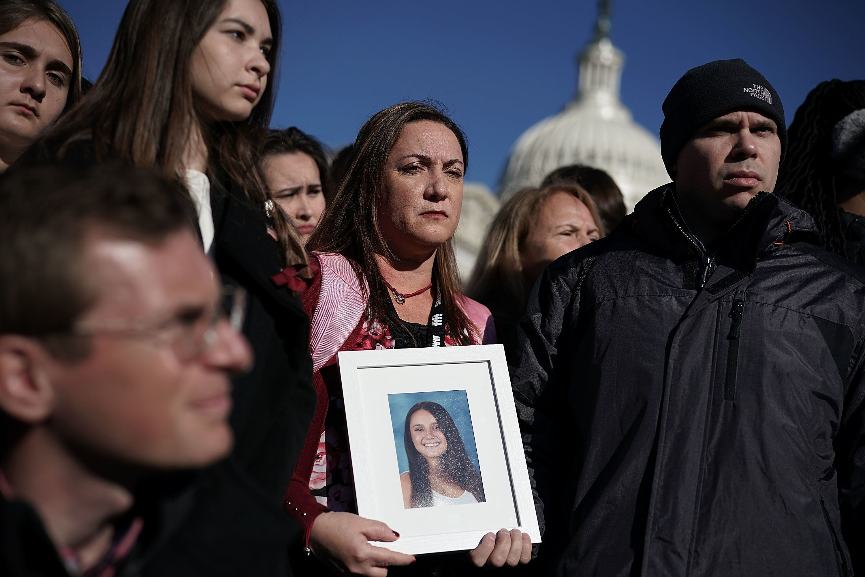 WASHINGTON, DC - MARCH 23:  Lori Alhadeff (C) and her husband Ilan Alhadeff (R) hold a picture of their daughter Alyssa Alhadeff, a Marjory Stoneman Douglas High School shooting victim, during a news conference on gun control March 23, 2018 on Capitol Hill in Washington, DC. U.S. Rep. Ted Deutch (D-FL), Sen. Bill Nelson (D-FL) and Sen. Amy Klobuchar (D-MN), joined by students and gun control advocates, held a news conference 'to demand action on gun safety.'  (Photo by Alex Wong/Getty Images)