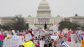 WASHINGTON, DC, UNITED STATES - 2017/01/21: People take part in the Million Woman March one day after the Trump inauguration in Washington DC. An estimated half-million people packed the streets of Washington for a Saturday rally against President Trump, with the angry turnout doubling that of his inauguration. (Photo by Stephen J. Boitano/LightRocket via Getty Images)