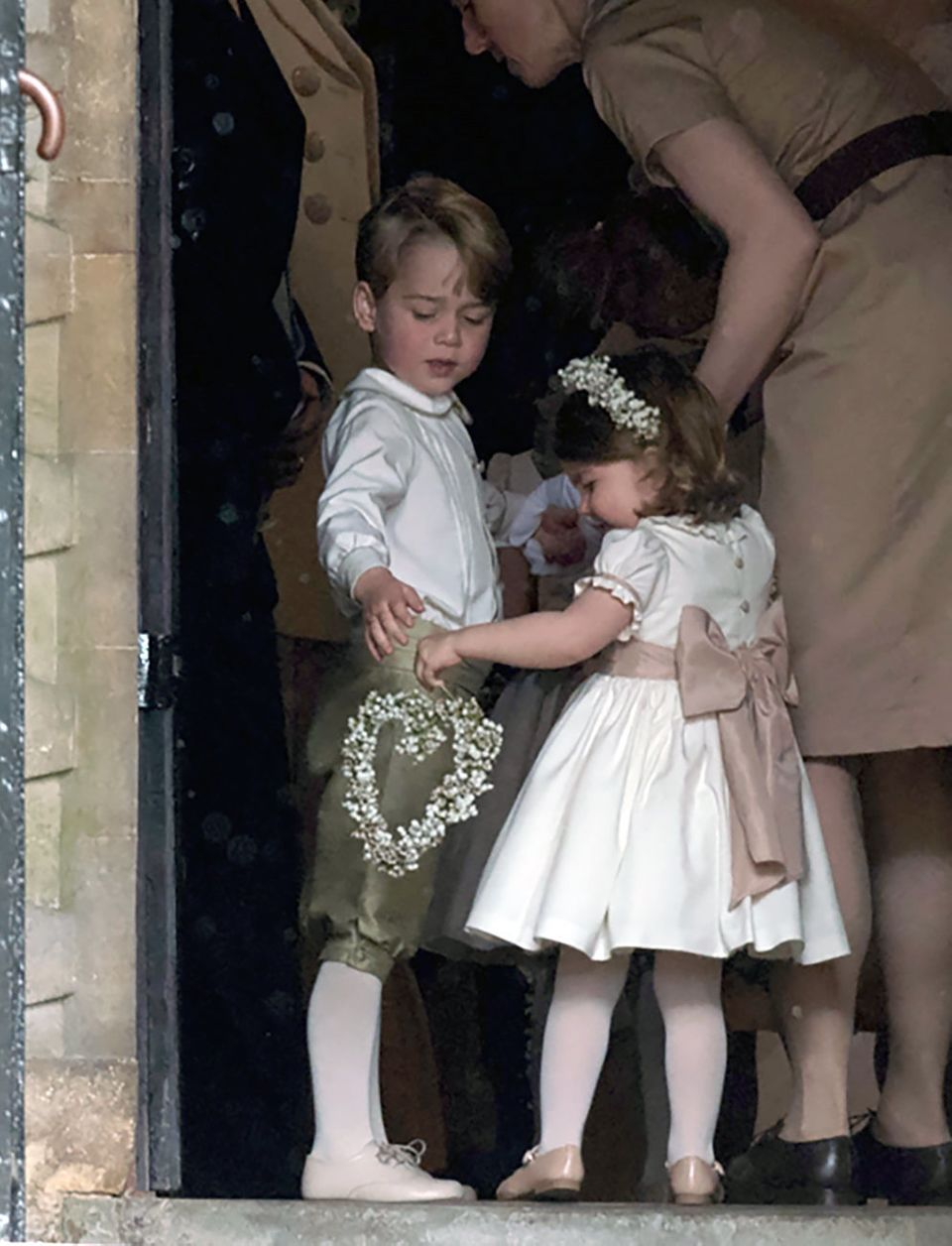 Prince George and his younger sister Princess Charlotte - pictured at Pippa Middleton's wedding - are...