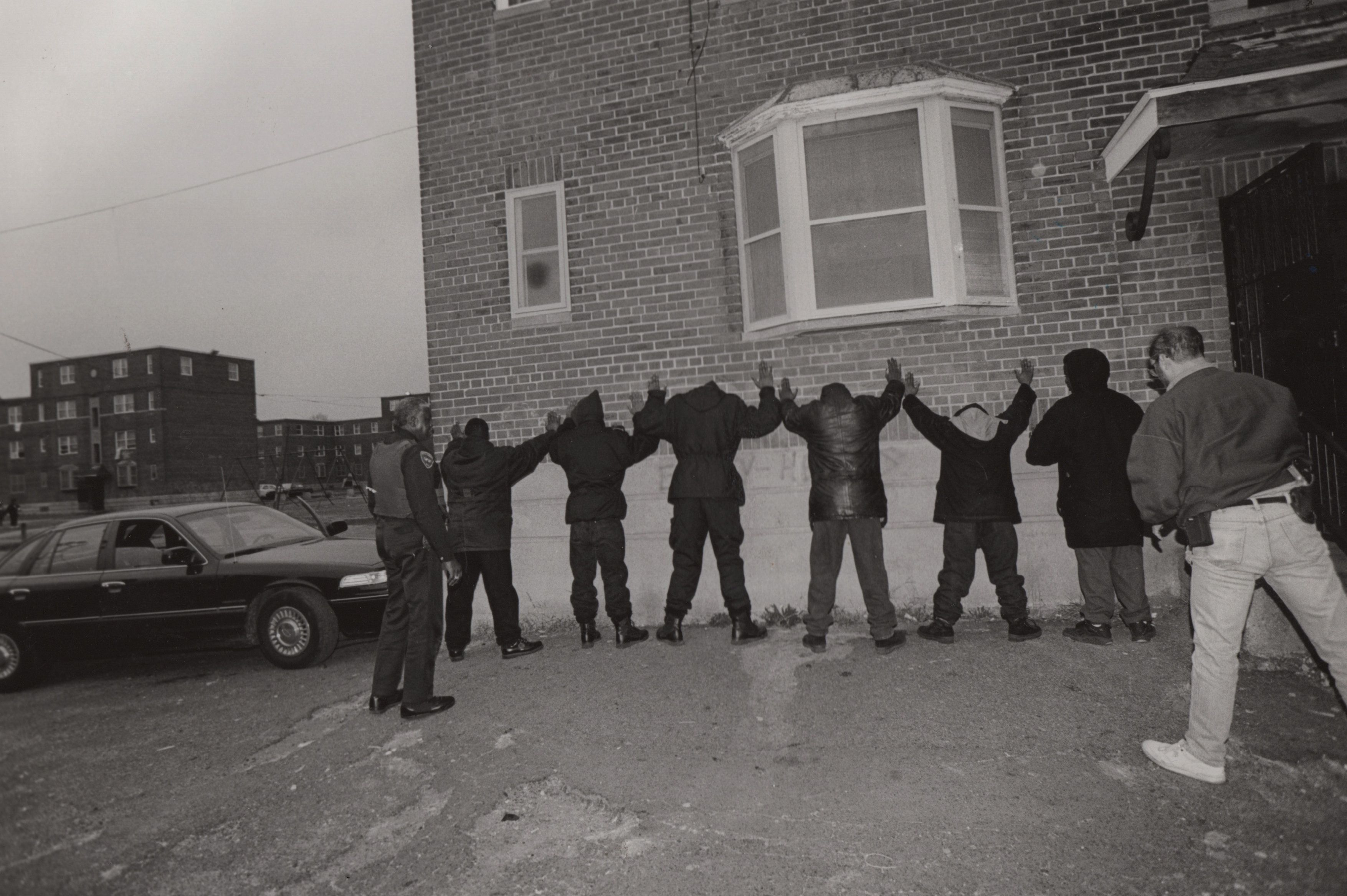 A special narcotics task force, formed by the police to combat the crack epidemic in Bridgeport, lines people up against a wall to search them in the Father Panic housing projects. (Photo by Andrew Lichtenstein/Corbis via Getty Images)