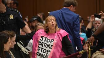 Protesters from Code Pink are removed before Gina Haspel testifies at the Senate Intelligence Committee on her nomination to be the next CIA director in the Hart Senate Office Building on Capitol Hill in Washington, DC on May 9, 2018. (Photo by MANDEL NGAN / AFP)        (Photo credit should read MANDEL NGAN/AFP/Getty Images)