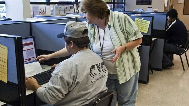 An employment specialist with the Nebraska Department of Labor helps a jobseeker in Omaha.