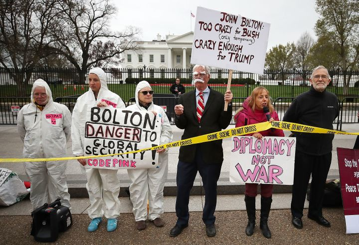 Members of Code Pink protest John Bolton's appointment as President Trump's national security advisor during a rally in front