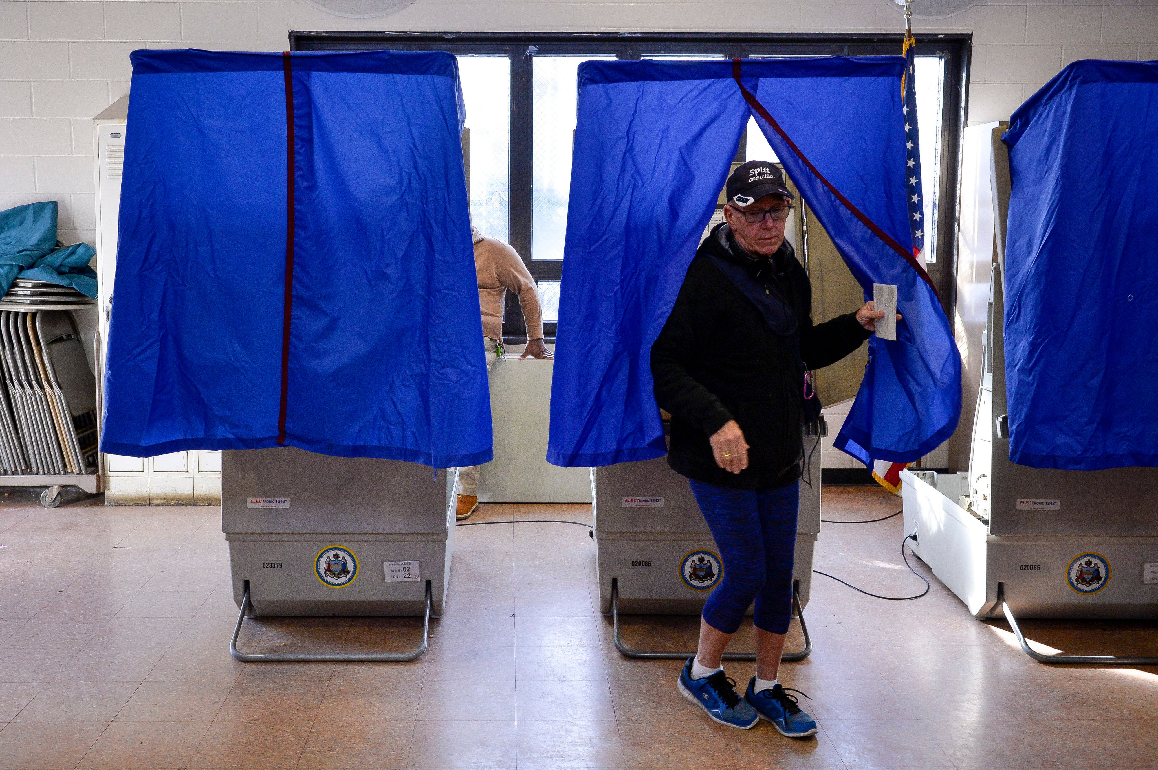 A voter leaves the polling booth during the U.S. presidential election in Philadelphia, Pennsylvania, U.S. November 8, 2016.  REUTERS/Charles Mostoller