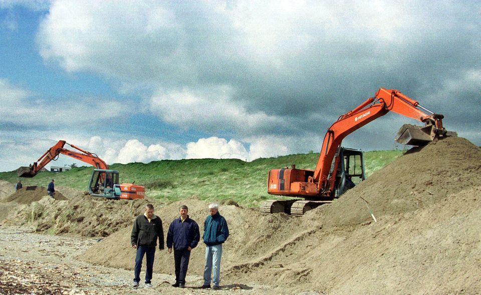 Relatives of Jean McConville stand between the diggers during the final hours of the search for...