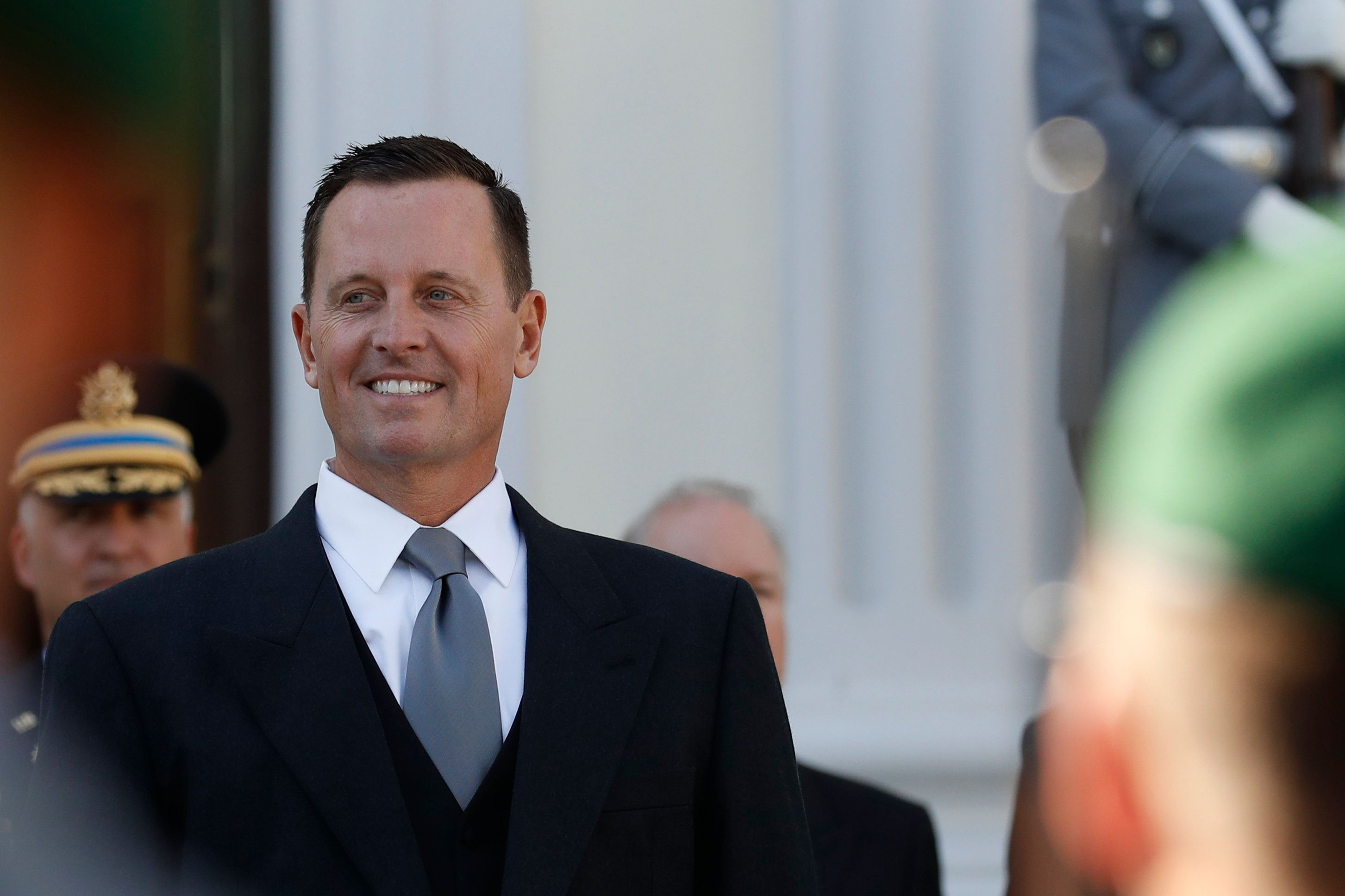 Newly accredited US Ambassador Richard Allen Grenell stands in front of a military honor guard during an accreditation ceremony for new Ambassadors in Berlin, Germany, on May 08, 2018. (Photo by Odd ANDERSEN / AFP)        (Photo credit should read ODD ANDERSEN/AFP/Getty Images)