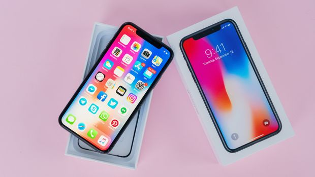 WARSAW, POLAND - DECEMBER 02, 2017: New Iphone X mobile phone with box on pink background