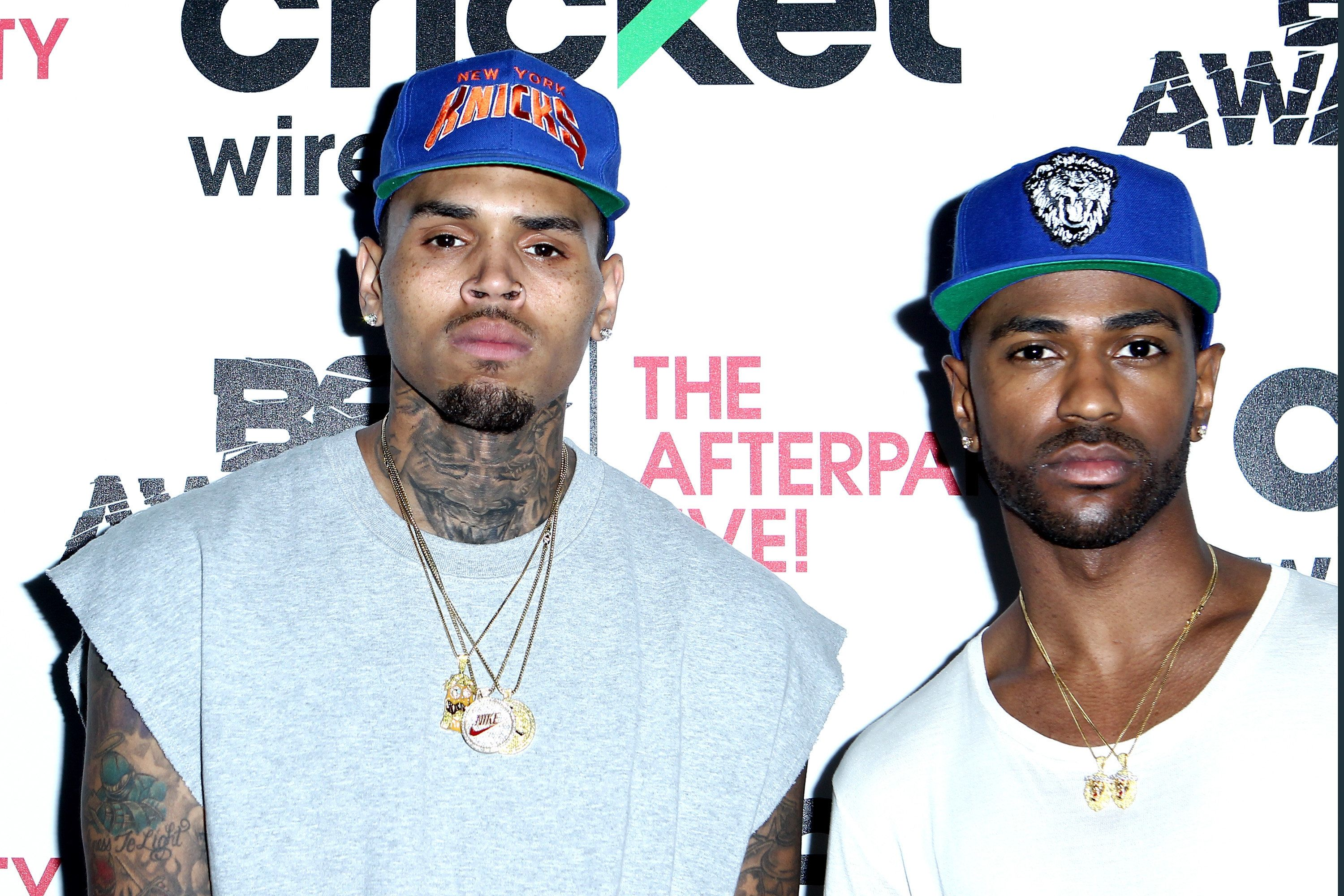 LOS ANGELES, CA - JUNE 28:  Singer Chris Brown (L) and rapper Big Sean attend the Cricket green lounge during the 2015 BET Awards at the Microsoft Theater on June 28, 2015 in Los Angeles, California.  (Photo by Leon Bennett/BET/Getty Images for BET)