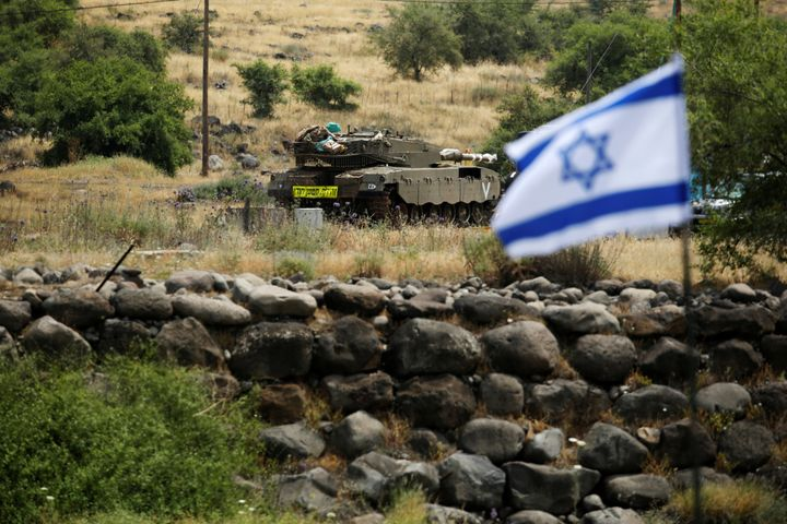 An Israeli tank can be seen near the Israeli side of the border with Syria in the Israeli-occupied Golan Heights, Israel May