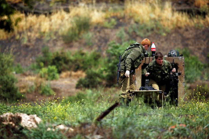 Israeli soldiers can be seen near the Israeli side of the border with Syria in the Israeli-occupied Golan Heights, Israel May