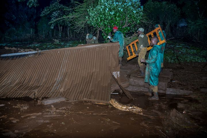 "Volunteers search for survivors after a dam burst in Kenya on Thursday and caused ""huge destruction,&rdq"