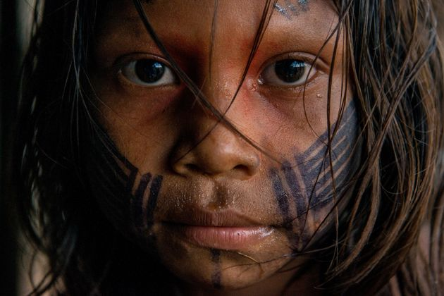 Portrait of a young girl from Kendjam village in Kayapó Territory, Brazilian