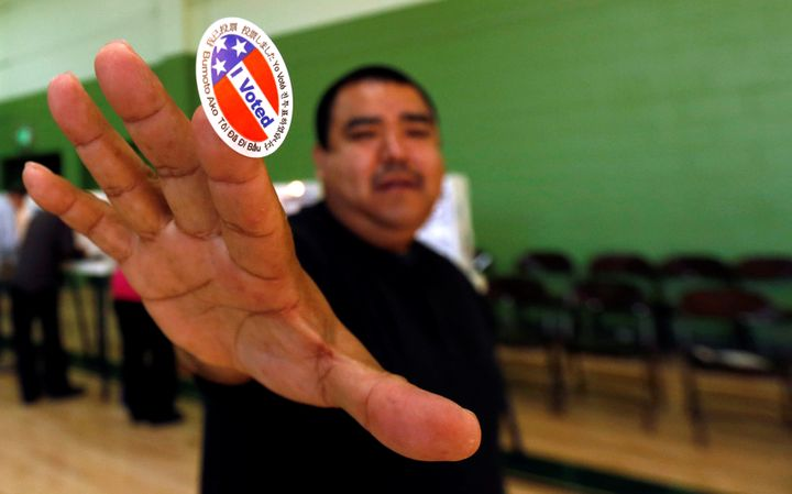 Anthony Partida shows his sticker after voting at the Evergreen Recreation Center on Election Day.
