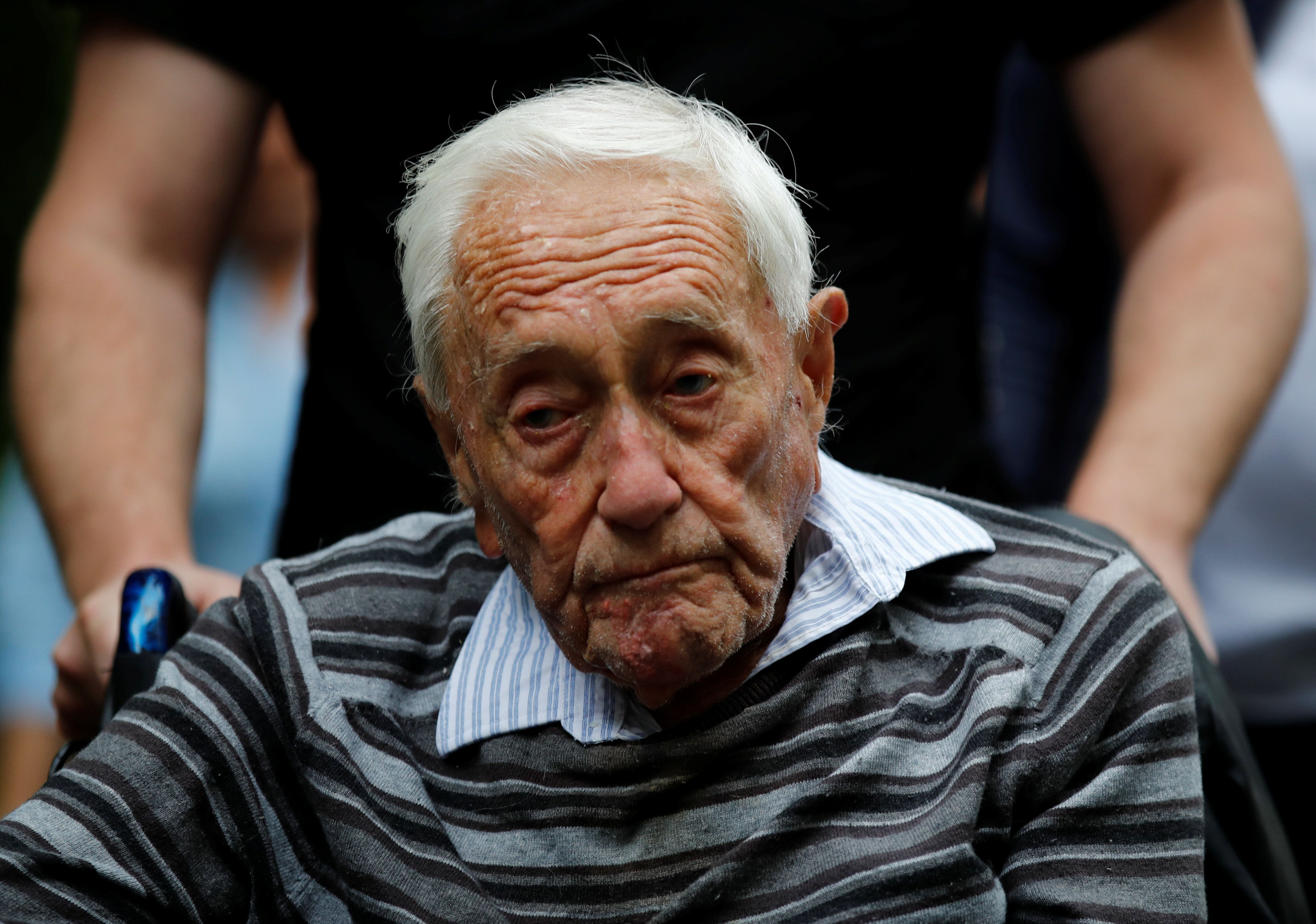 David Goodall, 104, arrives to hold a news conference a day before he intends to take his own life in assisted suicide, in Basel, Switzerland May 9, 2018. REUTERS/Stefan Wermuth
