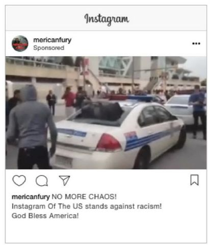 This sponsored Instagram ad features an image of a hooded black man standing next to a vandalized a police car