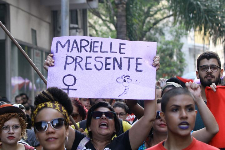 """""""Marielle Presente"""" -- or """"Marielle Is Present"""" -- became a rallying cry for protesters around the world after Franco's murde"""