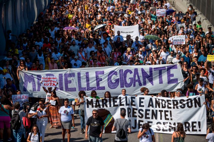 Demonstrators march through Mare, the Rio favela where Marielle Franco was born, to protest her killing in March.