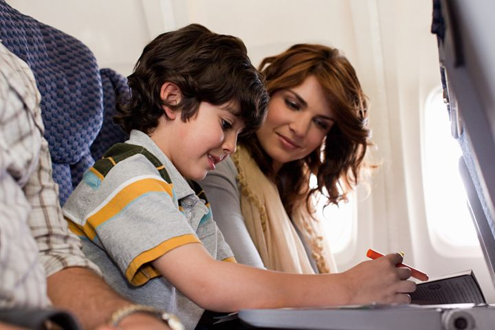 One of our travel experts recommended bringing small wrapped gifts like markers and toys to keep kids occupied on a flight.
