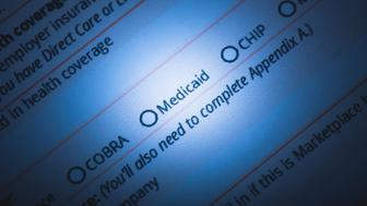 A stock photo of a US Healthcare / Health insurance application form. Photographed using Canon EOS 5DSR at 50mp. Focused on the words 'Medicaid'. Perfect for designs or articles about healthcare, health insurance, Obamacare or the affordable health care act.