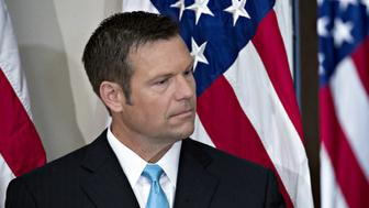 Kris Kobach, Kansass secretary of state, listens during the initial meeting of the Presidential Advisory Commission on Election Integrity at the Eisenhower Executive Office Building in Washington, D.C., U.S., on Wednesday, July 19, 2017. President Donald Trump created the advisory commission in May, after claiming without evidence that 3 million people or more illegally voted for Hillary Clinton last year. Photographer: Andrew Harrer/Bloomberg via Getty Images