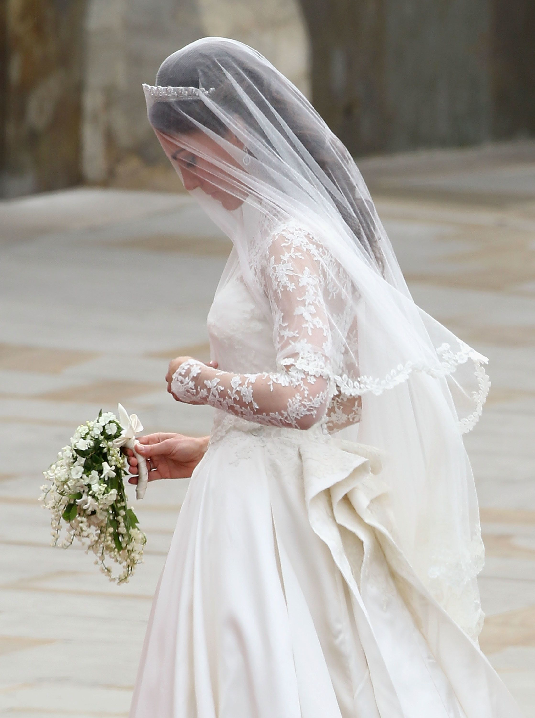 Kate, the Duchess of Cambridge, holding her wedding bouquet, which included a sprig of