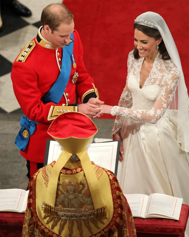 Prince William places the wedding ring on Kate's finger on April 29,