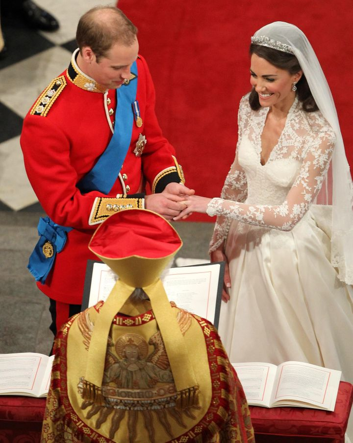 Prince William places the wedding ring on Kate's finger on April 29, 2011.