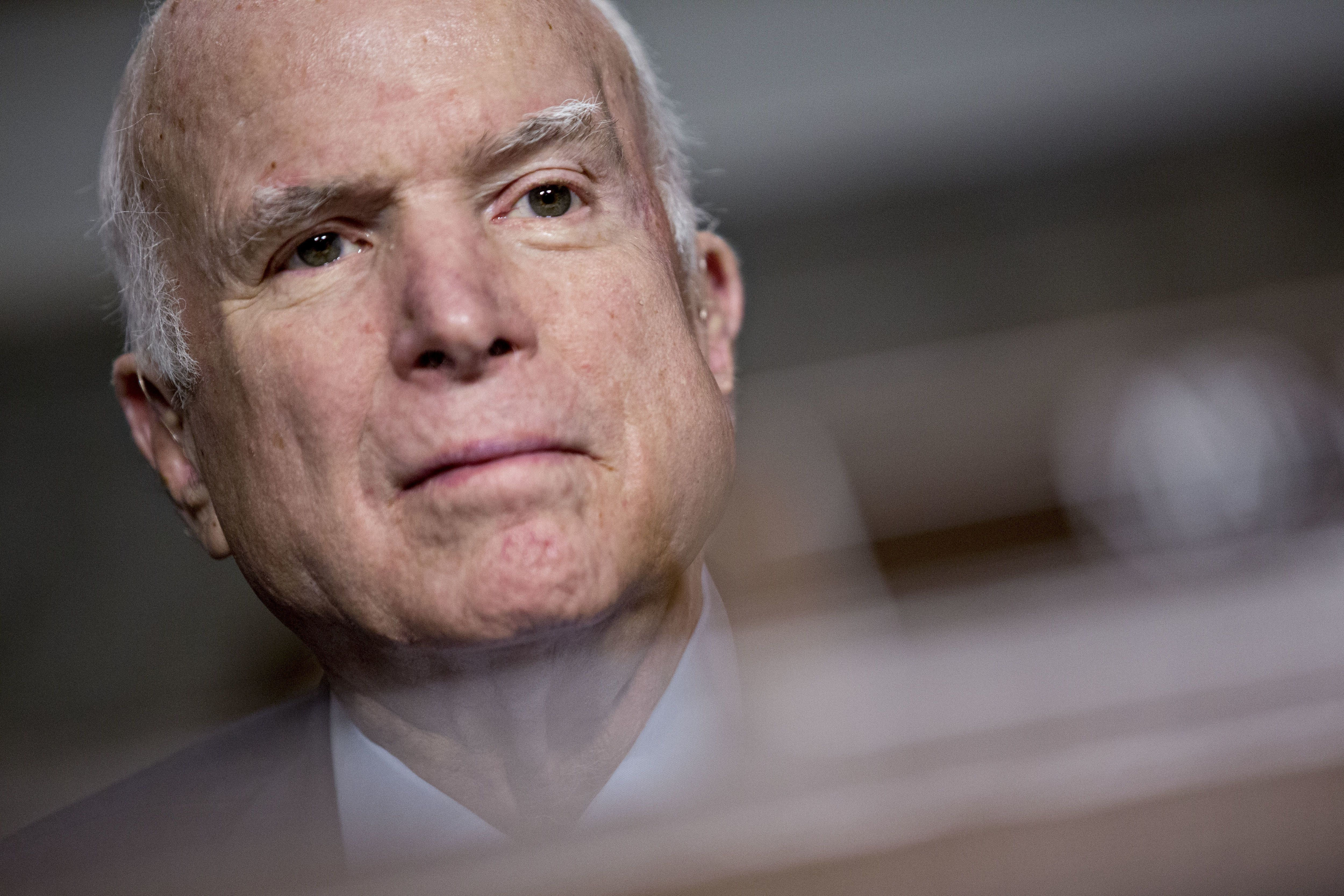 Senator John McCain, a Republican from Arizona and chairman of the Senate Armed Services Committee, listens during a hearing in Washington, D.C., U.S., on Thursday, Nov. 30, 2017. McCain said in a statement Thursday that he's decided to support the Senate tax bill. McCain hadn't taken an official position on the tax plan until now -- and no one was taking his vote for granted after he shocked the political world by voting against a rushed attempt to demolish the Affordable Care Act this summer. Photographer: Andrew Harrer/Bloomberg via Getty Images