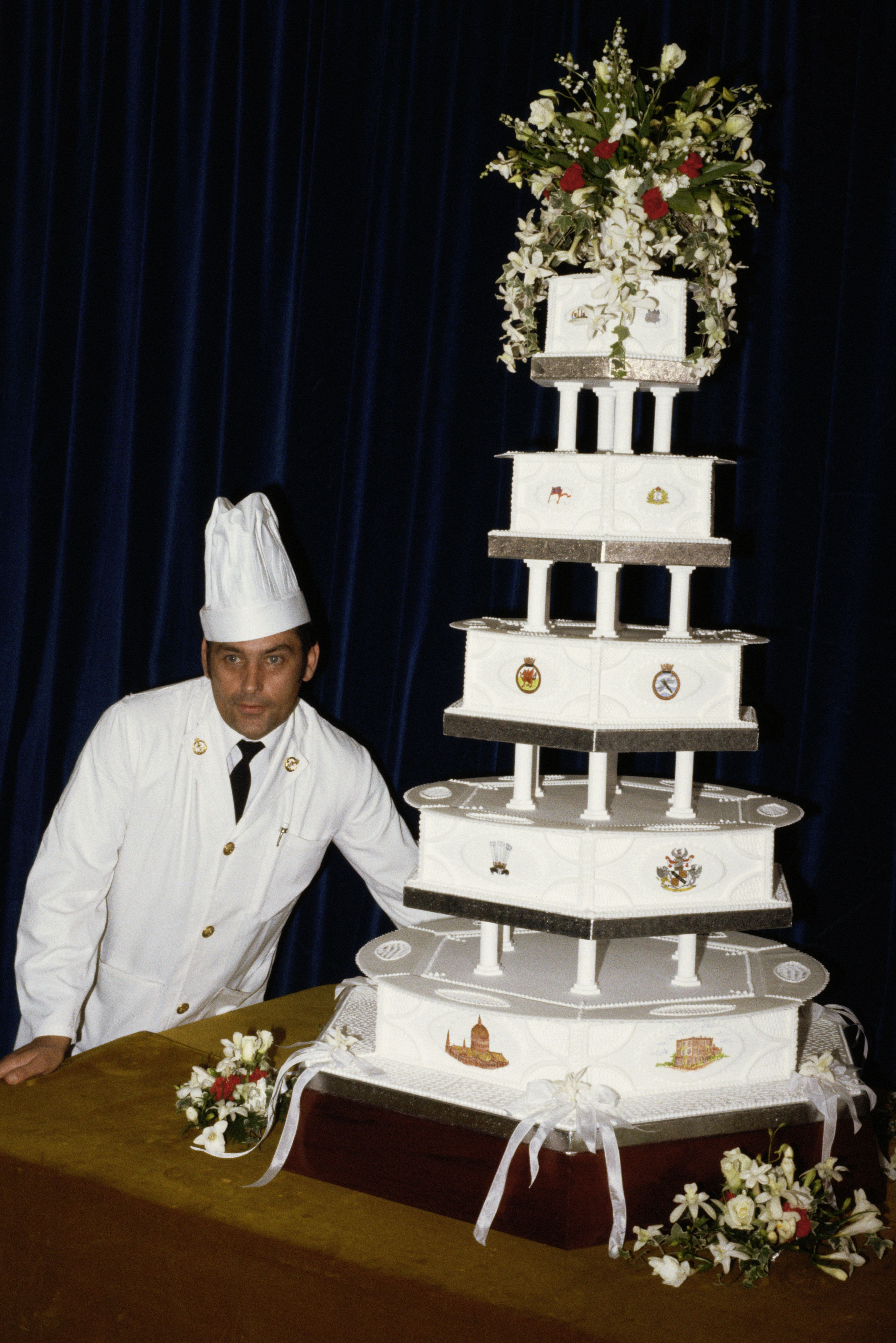 David Avery, head baker at the Royal Naval Cooking School, displays Charles and Diana's multi-tier fruitcake...
