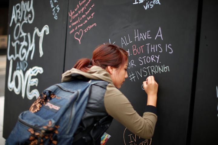 A student signs on a remembrance wall in the Isla Vista neighborhood of Santa Barbara, California May 27, 2014. Twenty-two ye