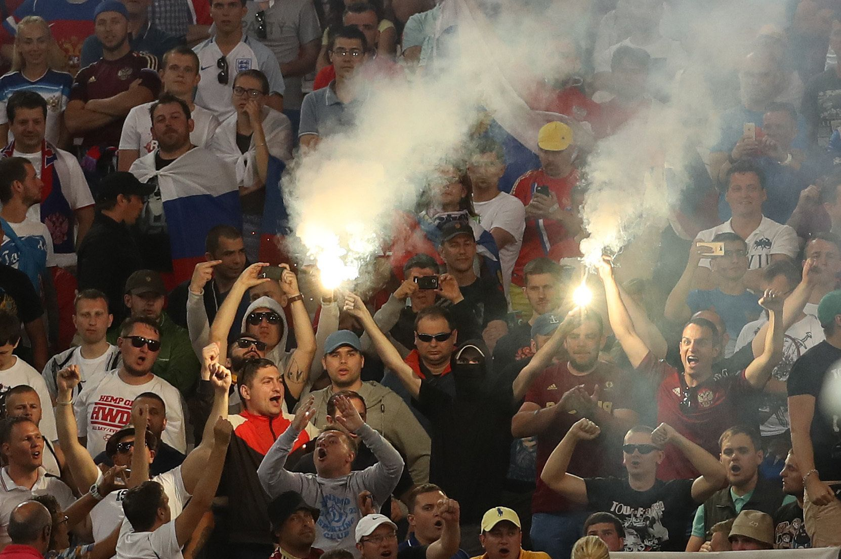 Russia fans let off flares during the UEFA Euro 2016, Group B match at the Stade Velodrome,