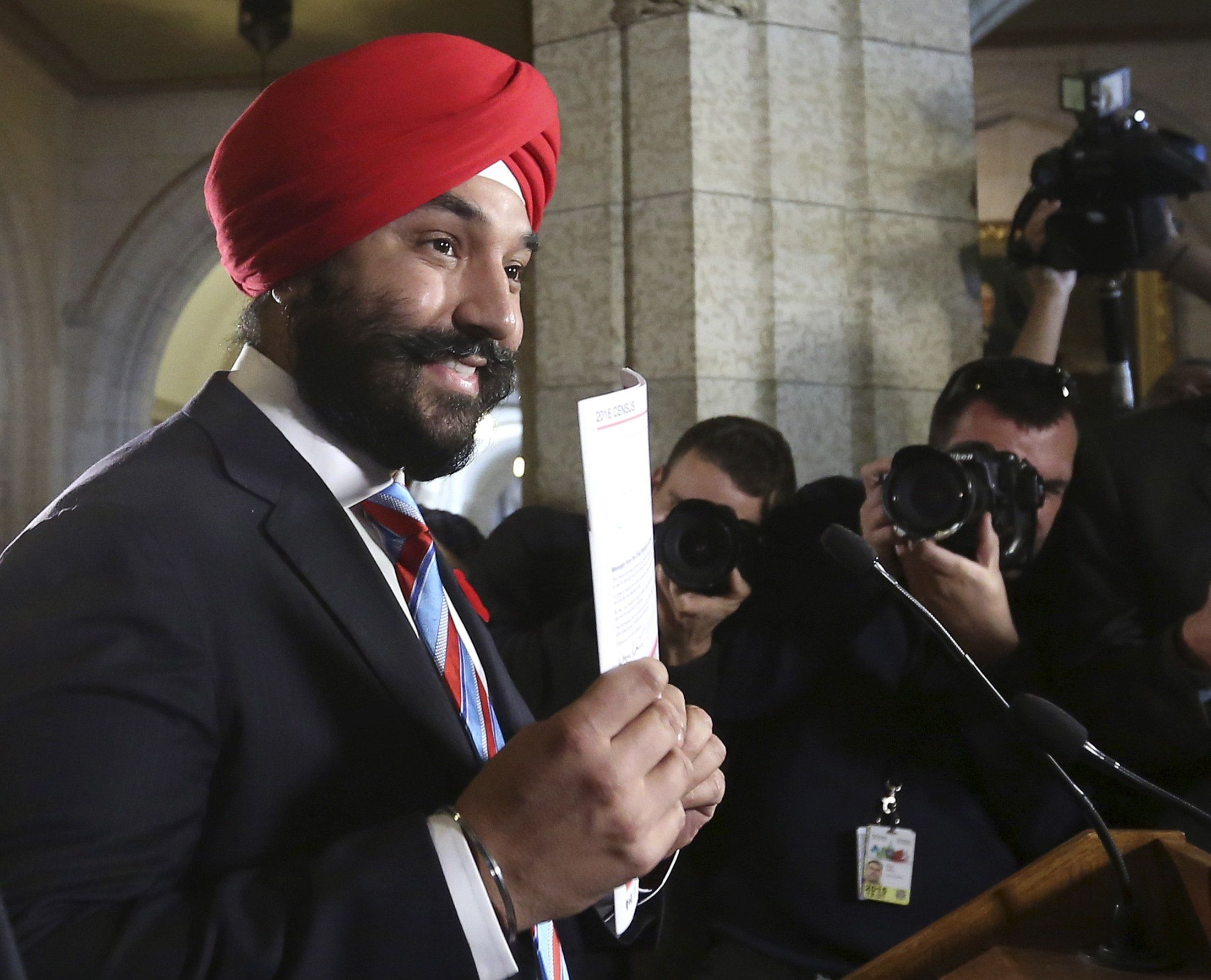 Canada's Innovation, Science and Economic Development Minister Navdeep Bains holds up a copy of a long-form census during a news conference on Parliament Hill in Ottawa, Canada November 5, 2015. REUTERS/Chris Wattie