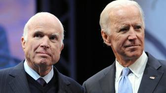 PHILADELPHIA, PA - OCTOBER 16: Sen. John McCain (R-AZ) receives the the 2017 Liberty Medal from former Vice President Joe Biden at the National Constitution Center on October 16, 2017 in Philadelphia, Pennsylvania. (Photo by William Thomas Cain/Getty Images)