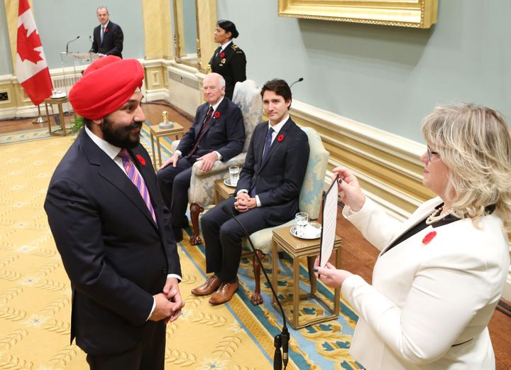 Canada's Navdeep Bains is sworn in as a Cabinet minister, with Prime Minister Justin Trudeau looking on, in Ottawa in N