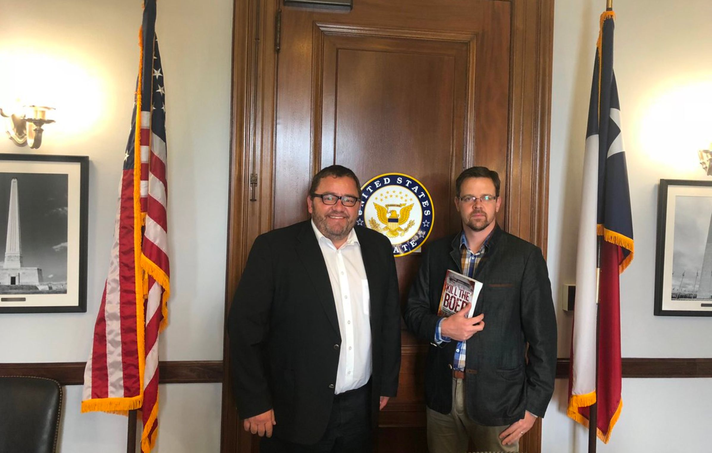 AfriForum heads Kallie Kriel and Ernst Roets pose for picture on Capitol Hill