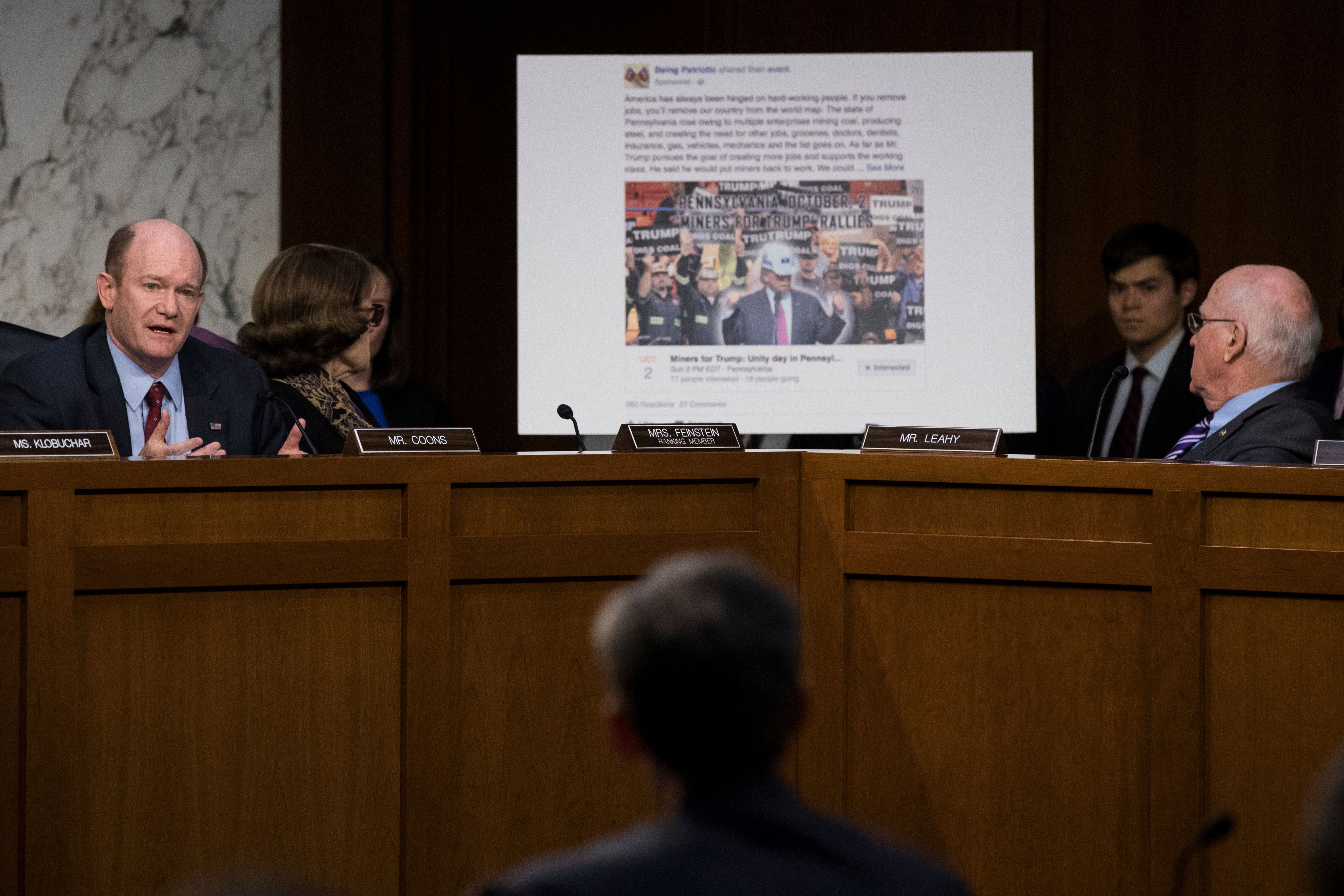 WASHINGTON, DC - OCTOBER 31: With a Facebook event page featuring a 'Miners For Trump' rally created by Russian operatives displayed behind him, Sen. Chris Coons (D-DE) questions witnesses during a Senate Judiciary Subcommittee on Crime and Terrorism hearing titled 'Extremist Content and Russian Disinformation Online' on Capitol Hill, October 31, 2017 in Washington, DC. The committee questioned the tech company representatives about attempts by Russian operatives to spread disinformation and purchase political ads on their platforms, and what efforts the companies plan to use to prevent similar incidents in future elections. (Drew Angerer/Getty Images)