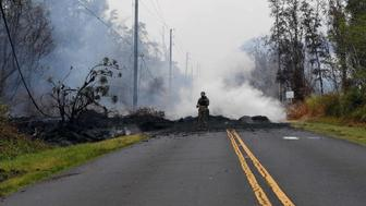 HAWAII, May 10, 2018  -- A soldier inspects the 'lava zone' in Leilani Estate, Hawaii, U.S., May 9, 2018. According to reports of the Hawaii State government, eruptions of the Kilauea Volcano had forced the evacuation of thousands of people. (Xinhua/Tao Xiyi via Getty Images)