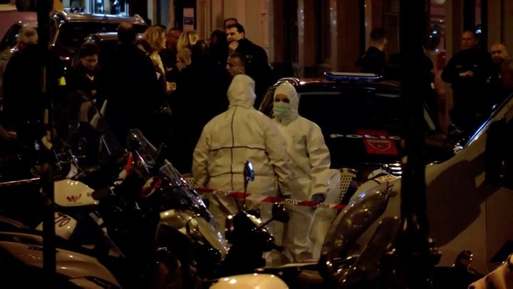 Personnel are seen at the scene of a knife attack in Paris on May 12 in this still image obtained from a video.