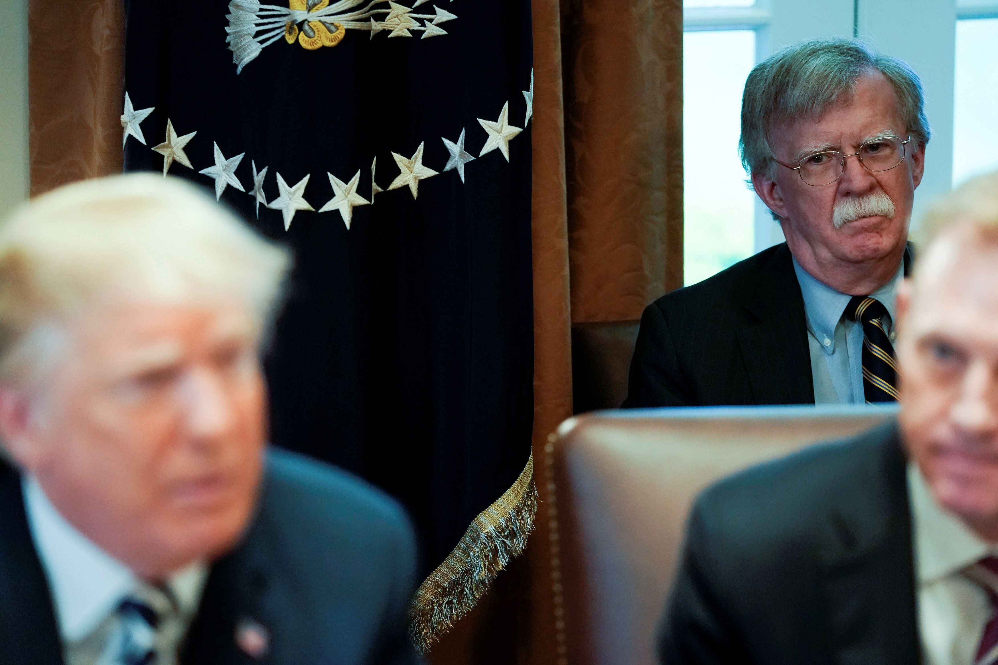 White House National Security Advisor John Bolton looks on as U.S. President Donald Trump holds a cabinet meeting at the White House in Washington, U.S. May 9, 2018.  REUTERS/Jonathan Ernst