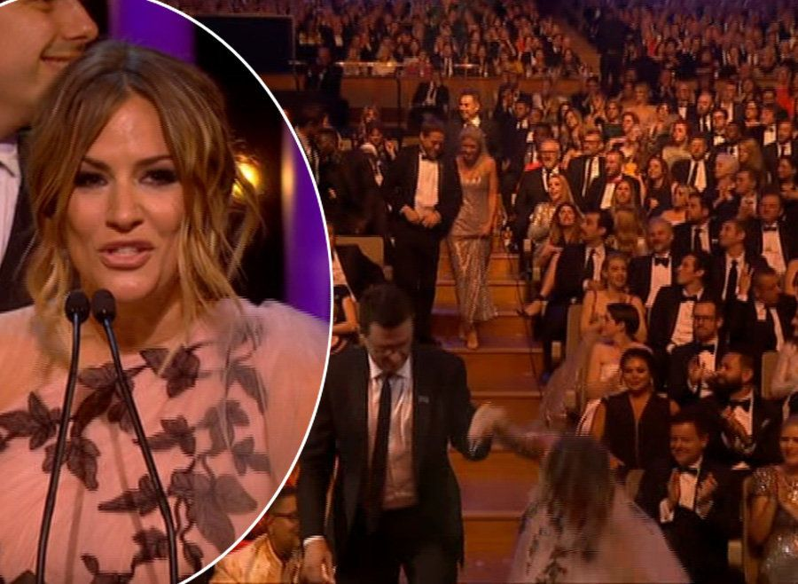 Caroline Flack Does A Jennifer Lawrence As She Trips On Way To Collect TV BAFTA For 'Love
