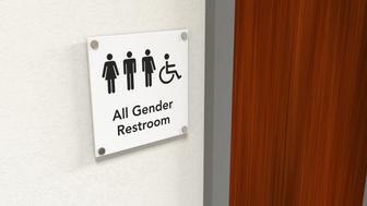 An all gender rest room sign next to a wooden bathroom door; black icons on white background
