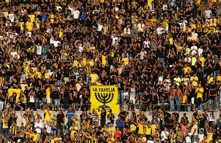 Beitar Jerusalem fans cheer before a 2016 match.