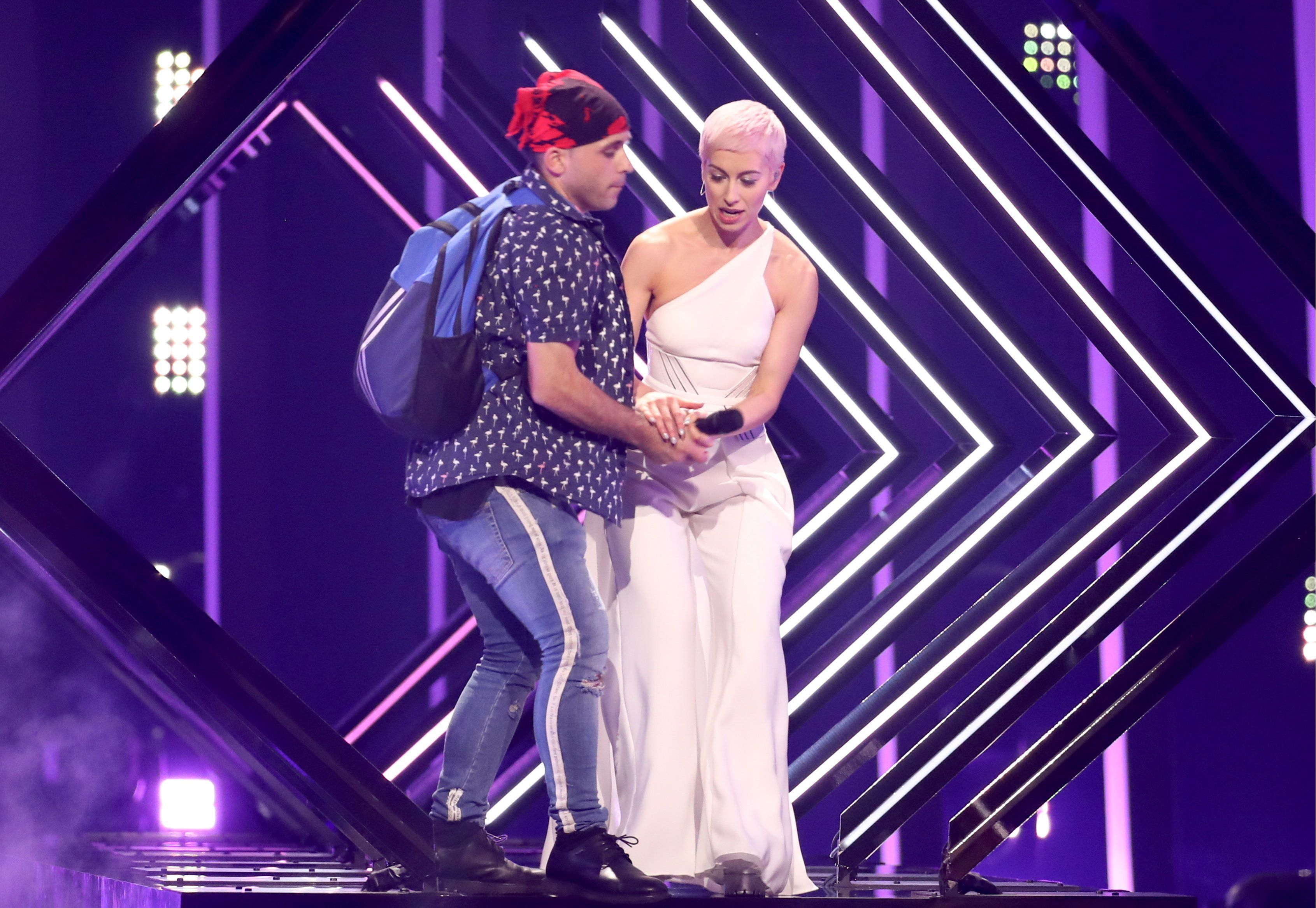 Vyacheslav Prokofyev via Getty Images                   SuRie's performance was interrupted by a stage invader