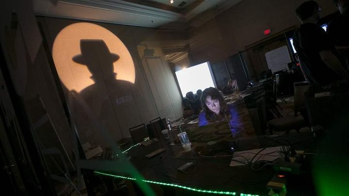 A tech associate works at the Black Hat information security conference in Las Vegas last year. Some states are turning to wh